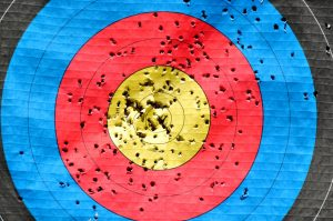 image of an archery target with multiple holes all over